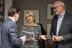 Director Carrie Hessler-Radelet speaks with former directors Mark Gearan and Dick Celeste.