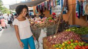 A Peace Corps Volunteer shops at a market in the Dominican Republic