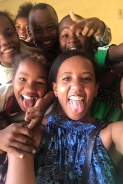 A group of people smile in Madagascar