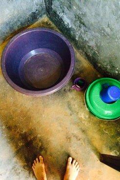 Bucket bath in Malawi