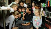 Moldova Volunteer Albert Sou reading to kids