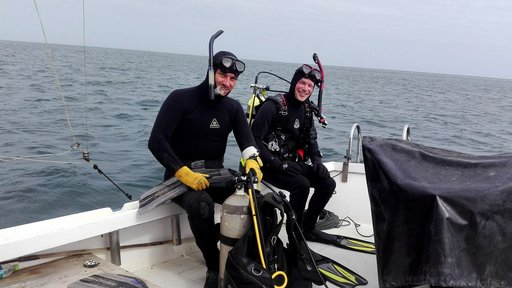 Peace Corps Response volunteer Christopher Giordano (right) with Dr. Yuri Hooker (left) before the first dive of their invest