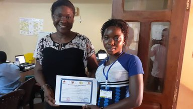 Two people holding a certificate
