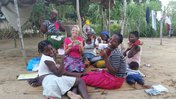 White American enjoys a snack with Mozambican colleagues and friends.