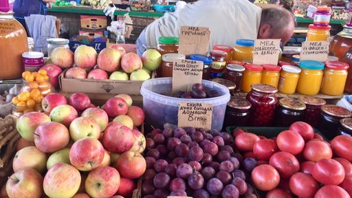 Apples, honey, plums, and other goods for sale at the bazaar.