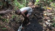 Village men digging trench to lay water pipes