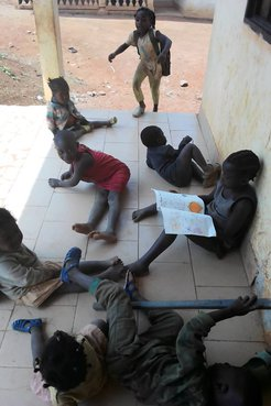 Students in Cameroon reading the books created by the students in California