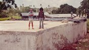 .      A Tongan construction foreman and I are standing on a concrete reservoir I designed.