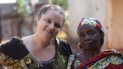 """A Peace Corps Volunteer health worker stands with the woman she thought of as """"momma,"""" in her Cameroonian community."""