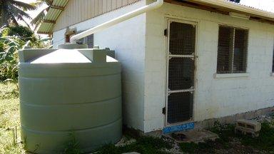 Volunteer house with water tank