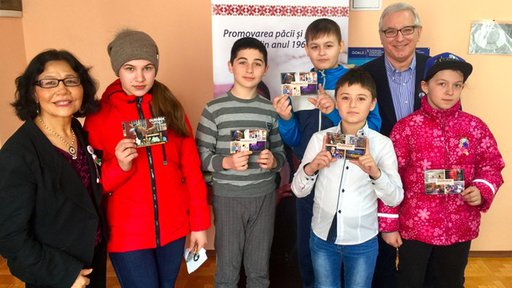 Older American man and woman with Moldovan students.