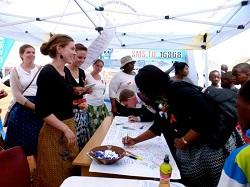 Community members sign in support of addressing gender based violence