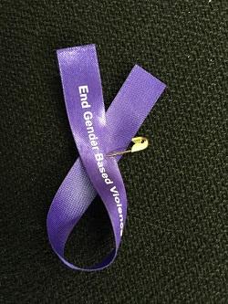 """The ribbon says """"End Gender Based Violence"""""""