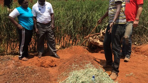 Modeste and I reviewing mulching practices, drip irrigation methods, and how the rain water runoff from the roof will enter t