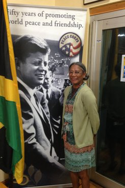 Person standing in front of JFK Peace Corps Sign