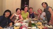 6 women sitting around a dinner time