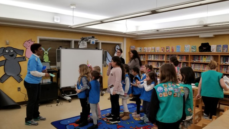 RPCVs speak to a Girl Scout troop during World Thinking Day