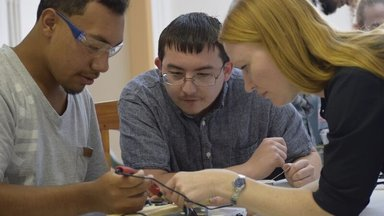 ASU team train youth in assembly of SolarSPELL device