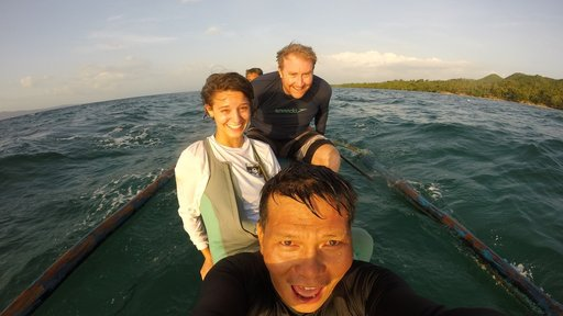 Morgan travels by boat to perform surveys of the local marine protected areas, with her coworkers Drew Sullivan (back, fellow
