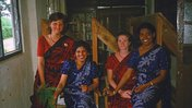 Four District English Language Improvement Center teachers pause for a photo in their matching kandyan sarees.