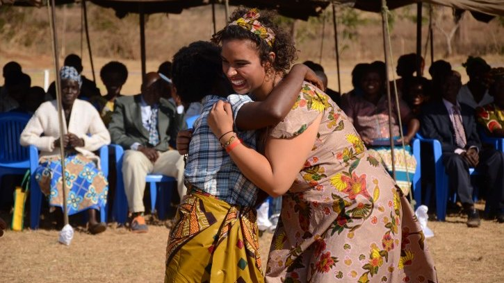 Peace Corps Malawi Volunteer running to hug her host mother