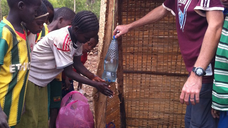 Ethiopia: Volunteer leads a hygiene activity highlighting the importance of handwashing.