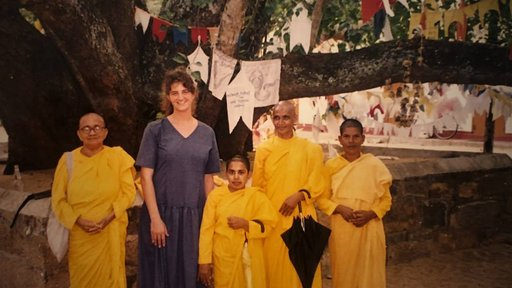 Peace Corps Volunteer with lady Buddhist monks