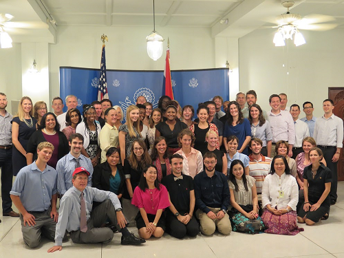 The Charge D'Affaires poses with Peace Corps volunteers and staff
