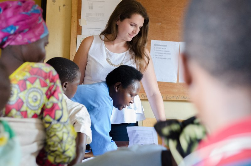 Peace Corps Rwanda Volunteer Caroline with her counterpart at a women's group meeting.