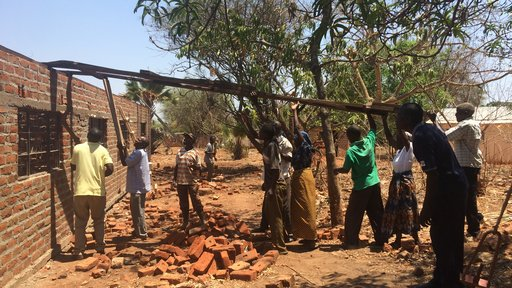 Volunteers put the roof onto our HIV treatment center
