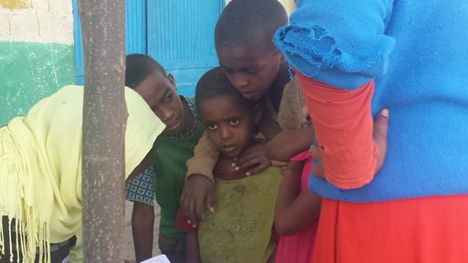 Children receive their trachoma prophylaxis medications at the annual trachoma campaign.