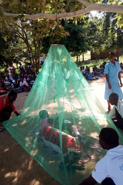 A bed net hanging demo led by Samuel