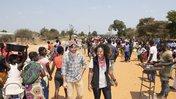 Emily Kroloff walks with community members in Zambia