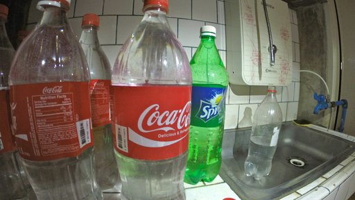 Our bottles of purified drinking water and the water filter, top right.