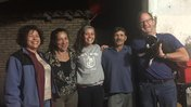 A PCV in Paraguay stand with both her biological parents and her host parents.