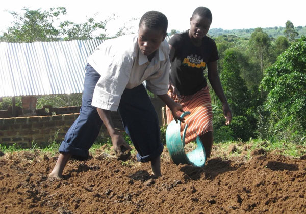 Children turning over soil