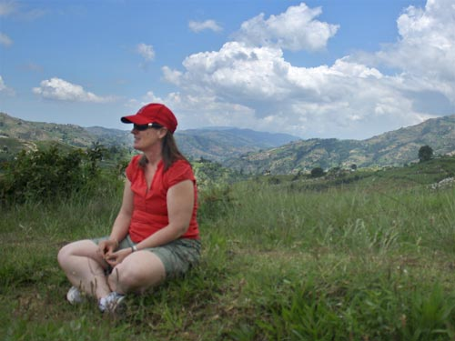 Lynne Moquete takes a moment to enjoy the Haitian/Dominican Republic border region during a business trip with her nonprofit, Building Homes Building Hope, in 2010.