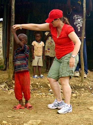 Lynne Moquete on a trip to Haiti with her nonprofit, Building Homes Building Hope.