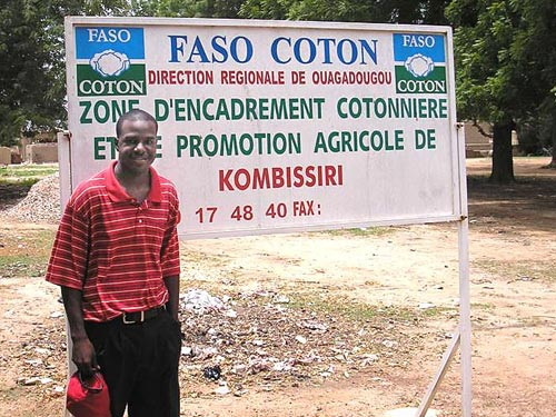 Courtney Owens stands on the property of the cotton cooperative where he worked as an advisor during his Volunteer service in Burkina Faso.