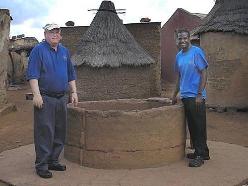 MI Coordinator John Paul Owens makes a visit. He and Courtney Owens inspect the well that the former built when he, himself, was a PCV.