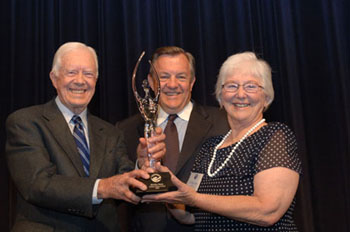 Lillian Carter Award winner Shirley Maly with former President Jimmy Carter and Director Tschetter