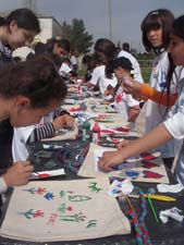 Students in Azerbaijan decorate re-usable grocery bags for Global Youth Service Day.