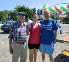 The oldest currently serving Peace Corps volunteer Bernie Cheriff (Left) returns home from Ukraine today.  Bernie is with Peace Corps volunteer Kaitlyn Hauter and a Peace Corps staff member at a half marathon held in Ukraine.