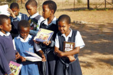 First Place in Category 1: Education and Prevention. Children in Botswana gather for a weekly library club at their primary school. Photo by Peace Corps volunteer Harmony Caton (Botswana, 2004-2006).