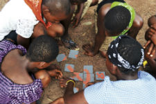 First Place in Category 4: Photographic Technical Merit. Participants of Camp GLOW (Girls Leading Our World) work on solving an HIV puzzle. Photo by Peace Corps volunteer Jeanna Rolsing (Ghana, 2010-2012).