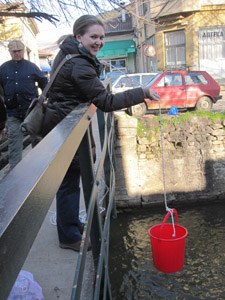 Peace Corps/Macedonia volunteer Katie Kalinowski collects water to test.