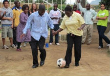 Tanzanians participate in a Grassroot Soccer training session.