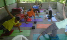 Pregnant women practicing yoga in the new center.