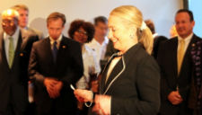 Secretary of State Clinton administers the swearing-in oath to 19 Peace Corps volunteers in Senegal.