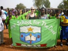 Peace Corps volunteer Lauren Corke marches with her deaf students in a parade on Ghanaian independece day.